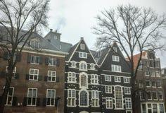 Sławni budynki i miejsce Amsterdam centrum miasta przy słońce ustalonym czasem Generała krajobrazu widok Fotografia Stock