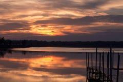 Słońca położenie chmurnieje kolorowego Obrazy Royalty Free