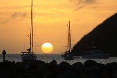 Słońce ustawia na zatoce w St Lucia Obraz Royalty Free