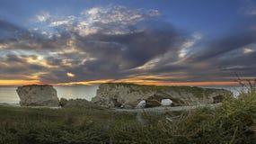 Słońce ustawia nad zachodnim wybrzeżem wodołaz & labrador Zdjęcia Stock