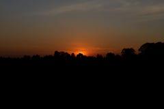 Słońce wzrost i słońca ustalony tło Obrazy Stock