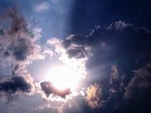 Słońce z chmurami obrazy royalty free