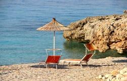 Słomiani parasole na plaży Obrazy Stock