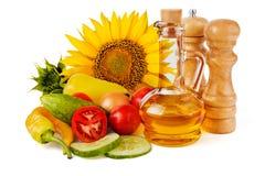 Słonecznikowy nasieniodajny olej i warzywa Fotografia Stock