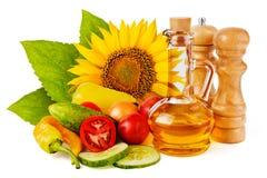 Słonecznikowy nasieniodajny olej i warzywa Fotografia Royalty Free