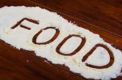 Słowa jedzenie pisać w stevia proszku na drewnianym tle Zdjęcia Royalty Free