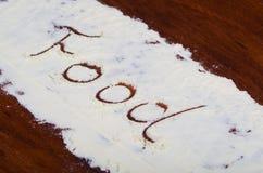 Słowa jedzenie pisać w stevia proszku na drewnianym tle Obraz Stock