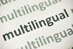 Słowa multulingual drukowany na papierowy makro- zdjęcie royalty free