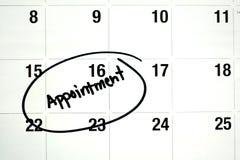 Słowa spotkanie Okrążający na kalendarzu zdjęcia royalty free