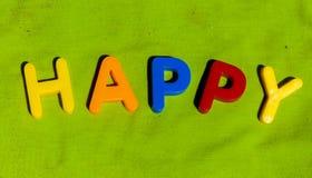 Słowa Szczęśliwy opanowany od listów zdjęcie royalty free