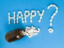 Słowa Szczęśliwy writted z pigułkami Obraz Royalty Free