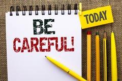 Słowa writing tekst Był Ostrożny Biznesowy pojęcie dla ostrożności uwagi zawiadomienia Ostrzegawczej opieki Wystrzega się Zbawczą Fotografia Stock