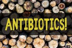 Słowa writing teksta antybiotyki Biznesowy pojęcie dla Antibacterial leka odkażalnika Aseptyczny Sterylizuje Sanitarny Drewnianeg zdjęcia royalty free