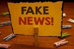 Słowa writing teksta imitaci wiadomości Motywacyjny wezwanie Biznesowy pojęcie dla Fałszywego Niepotwierdzonego Ewidencyjnego Hoa obrazy stock