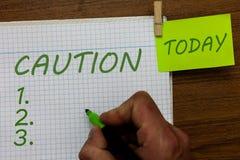 Słowa writing teksta ostrożność Biznesowy pojęcie dla opieki brać unikać niebezpieczeństwa lub błędów znaka ostrzegawczego zapobi obrazy stock