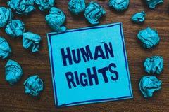 Słowa writing teksta prawa człowieka Biznesowy pojęcie dla Moralnych zasad standardów norm ludzie ochraniający prawo Błękitnego p fotografia stock