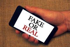 Słowa writing teksta real Lub imitacja Biznesowy pojęcie dla sprawdzać jeżeli produkty są oryginalni lub sprawdzać ilość właścici zdjęcia stock