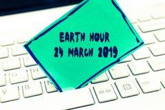 Słowa writing teksta ziemi godzina 24 Marzec 2019 Biznesowy pojęcie dla Świętowałam trwałości Save planeta Zaświeca Daleko zdjęcie royalty free