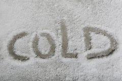 Słowa zimno w śniegu Obrazy Royalty Free