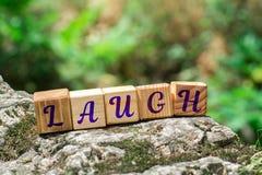 Słowo śmiech na kamieniu obraz stock
