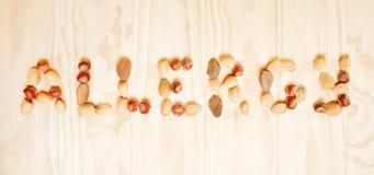 Słowo alergia pisać różne dokrętki Zdjęcie Royalty Free