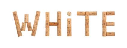 Słowo biel kształtujący wino korkami odizolowywającymi na bielu Obrazy Stock