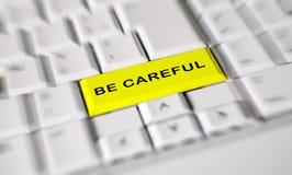 Słowo był ostrożny na komputerowym klawiaturowym kluczu obrazy royalty free