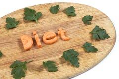 Słowo dieta od marchewek z liśćmi pietruszka Fotografia Stock