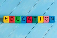 Słowo edukacja na children colourful sześcianach lub Zdjęcia Royalty Free