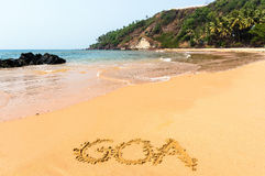 Słowo Goa na plaży - pojęcie wakacje tło indu zdjęcie stock