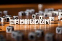 Słowo hipoteka robić biali klingerytów bloki na stole zdjęcia royalty free