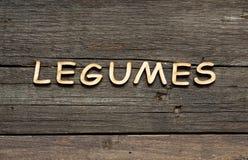 Słowo Legumes na drewnianym stole Zdjęcia Stock