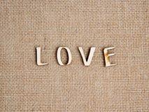 Słowo miłość na burlap zdjęcia royalty free