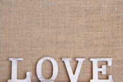 Słowo miłość na burlap Fotografia Royalty Free