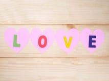 Słowo miłość na notebaper 1 Obraz Stock
