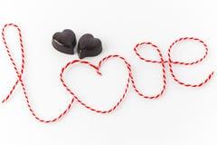 Słowo miłość z dwa czekoladowymi sercami Obraz Stock