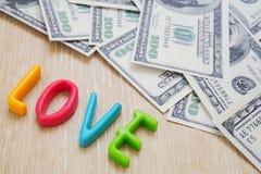 Słowo miłość z pieniądze Obrazy Royalty Free