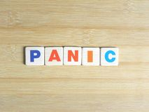 Słowo panika na drewnianym tle fotografia stock