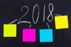 Słowo 2018 pisać na blackboard z pustymi notatkami Nowy Ye Zdjęcie Stock