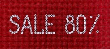 Słowo sprzedaż zrobi rhinestones krystaliczny kolor na czerwonym kanwa plecy Zdjęcia Royalty Free