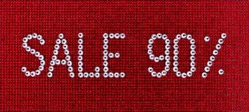 Słowo sprzedaż zrobi rhinestones krystaliczny kolor na czerwonym kanwa plecy Zdjęcie Royalty Free