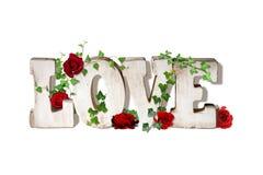 Słowo sztuki miłość z różami Fotografia Royalty Free