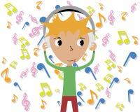 słuchająca chłopiec muzyka Fotografia Royalty Free
