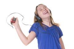 słuchająca dziewczyny muzyka Obrazy Stock
