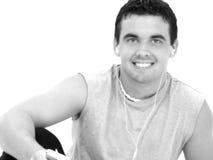 słuchanie muzyki człowiek atrakcyjna młoda Zdjęcie Stock