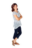 30s的妇女在与条纹和牛仔裤的上面 免版税库存照片
