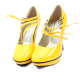 s穿上鞋子妇女黄色 免版税库存图片