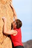 S'élever - grimpeur de roche Photographie stock