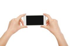 ` S женщины вручает держать мобильный телефон, урожай, отрезало вне стоковые изображения