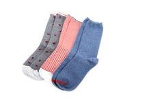 ` S женщин сортировало изолированные носки в различных дизайнах Стоковые Фотографии RF
